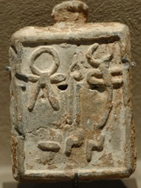 Square weight bearing the sign of Tanit, 5th - 2nd centuries BCE, Phoenician kingdom of Arados