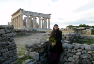 Laura in Priestess House with Temple behind