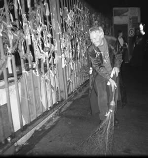 John Crow sweeps the portal, Halloween of Cross Bones 2005 (photo Max Reeves)