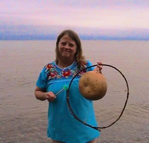 Janet Reynolds with a waterdrum she made. See below for more information about the waterdrums!